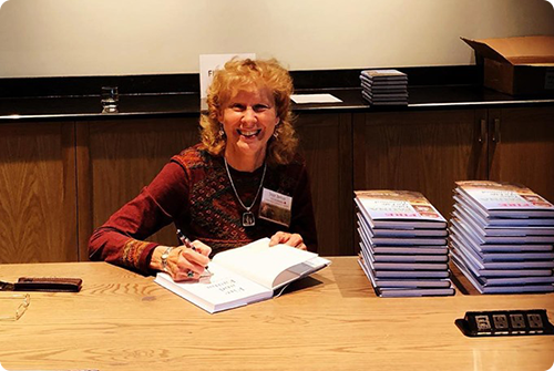 "Joan Berish signing her new book ""Fire and Fauna: Tales of a Life Untamed. Photo by Deb Burr"